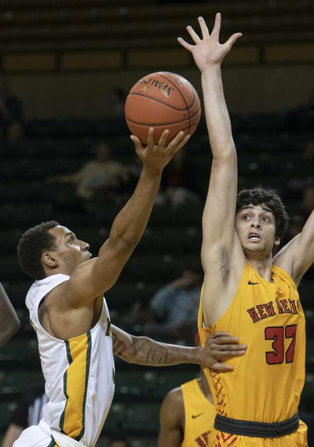 Midland College's Thomas Miles puts up a shot as New Mexico Junior College's Joao Carmargo defends 01/27/20 at the Chaparral Center. Tim Fischer/Reporter-Telegram Photo: Tim Fischer/Midland Reporter-Telegram