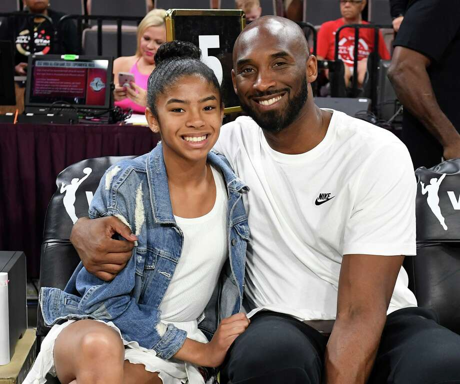 Gianna Bryant and her father, former NBA player Kobe Bryant, attend the WNBA All-Star Game 2019 at the Mandalay Bay Events Center on July 27, 2019 in Las Vegas, Nev. (Ethan Miller/Getty Images/TNS) Photo: Ethan Miller, HO / TNS / Getty Images North America