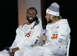 San Francisco 49ers' Richard Sherman, left, and Kansas City Chiefs' Tyrann Mathieu chat during Opening Night for the NFL Super Bowl 54 football game Monday, Jan. 27, 2020, at Marlins Park in Miami. (AP Photo/David J. Phillip)