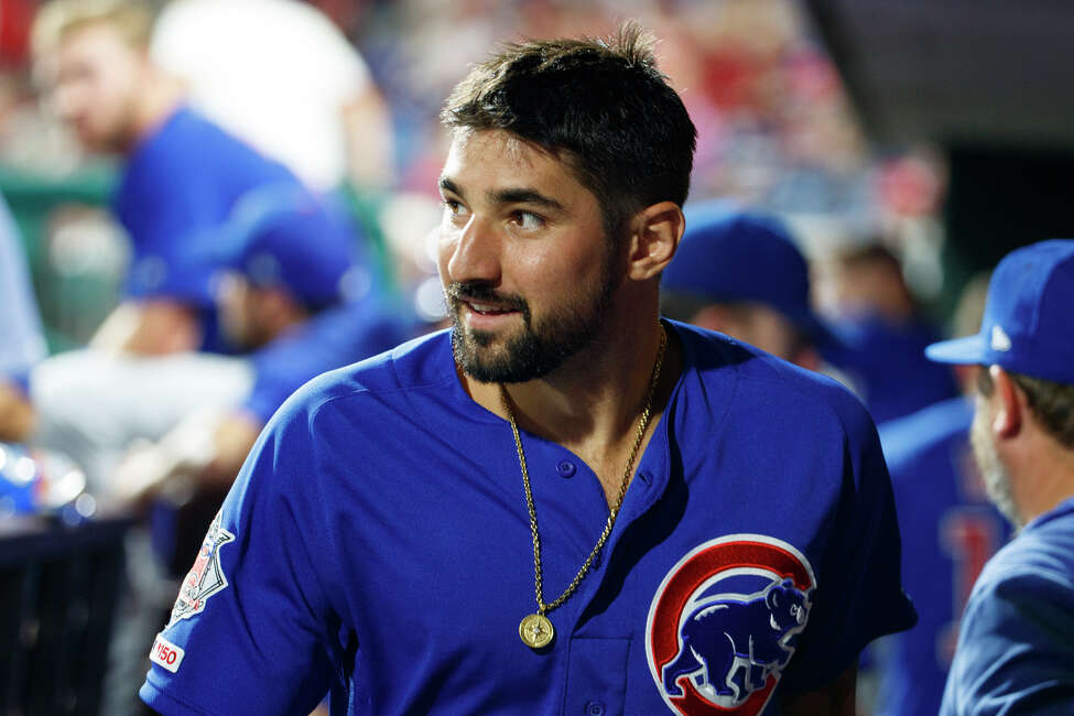 FILE - In this Aug. 15, 2019, file photo Chicago Cubs' Nicholas Castellanos looks on during the eighth inning of a baseball game against the Philadelphia Phillies in Philadelphia. Castellanos agreed to a $64 million, four-year deal Monday in the Cincinnati Reds' latest big-money move to emerge from years of losing, a person familiar with the deal told The Associated Press on Monday, Jan. 27, 2020. (AP Photo/Chris Szagola, File)