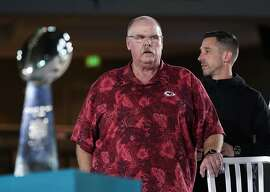 Kansas City Chiefs' coach Andy Reid, left, stands next to San Francisco 49ers coach Kyle Shanahan during Opening Night for the NFL Super Bowl 54 football game Monday, Jan. 27, 2020, at Marlins Park in Miami. (AP Photo/David J. Phillip)