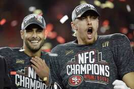 San Francisco 49ers quarterback Jimmy Garoppolo, left, and tight end George Kittle celebrate after the NFL NFC Championship football game against the Green Bay Packers Sunday, Jan. 19, 2020, in Santa Clara, Calif. The 49ers won 37-20 to advance to Super Bowl 54 against the Kansas City Chiefs.