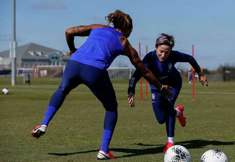 U.S. women's national team forwards Jessica McDonald, left, and Megan Rapinoe execute a drill during Sunday's practice at Houston Sports Park.