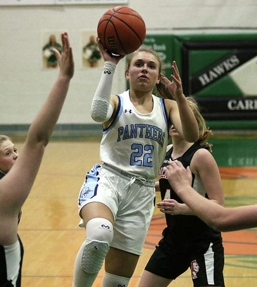 Jersey's Clare Breden (22) puts up a runner in the lane during the second half of the Panthers' victory over Calhoun on Monday night in a quarterfinal of the 46th annual Carrollton Tournament. Photo: Greg Shashack / The Telegraph