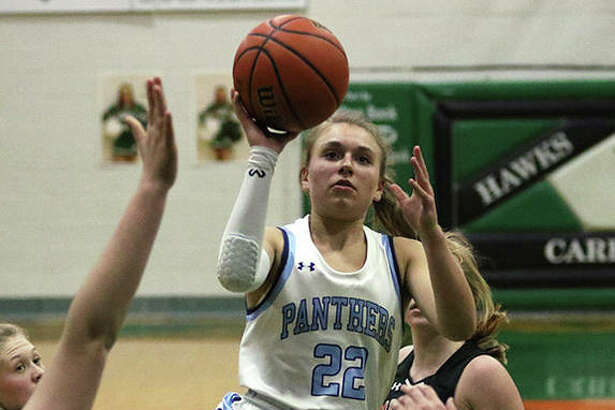 Jersey's Clare Breden (22) puts up a runner in the lane during the second half of the Panthers' victory over Calhoun on Monday night in a quarterfinal of the 46th annual Carrollton Tournament.