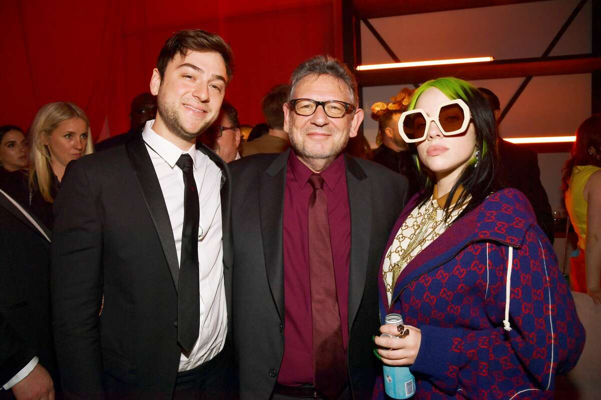 LOS ANGELES, CALIFORNIA - JANUARY 26: CEO of UMG Sir Lucian Grainge (C) and Billie Eilish (R) attend the Universal Music Group's 2020 Grammy after party presented by Lenovo at Rolling Greens Nursery on January 26, 2020 in Los Angeles, California. (Photo by Lester Cohen/Getty Images for Universal Music Group)