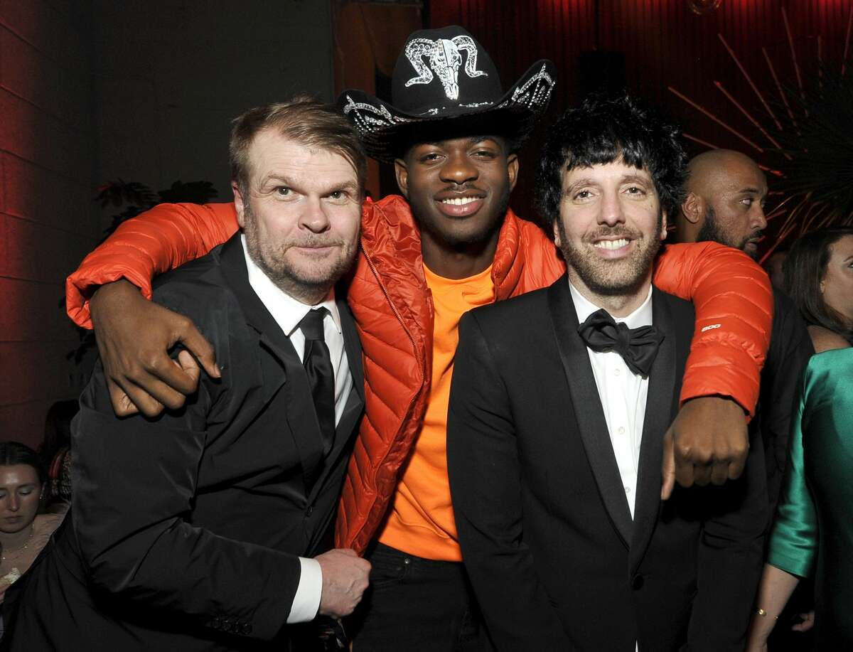 LOS ANGELES, CALIFORNIA - JANUARY 26: (L-R) Sony Music Group Chairman Rob Stringer, Lil Nas X, and Columbia Chairman & CEO Ron Perry attend the Sony Music Entertainment 2020 Post-Grammy Reception at NeueHouse Hollywood on January 26, 2020 in Los Angeles, California. (Photo by John Sciulli/Getty Images for Sony)