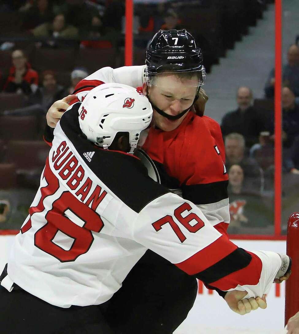 Ottawa Senators left wing Brady Tkachuk (7) fights New Jersey Devils defenseman P.K. Subban (76) during second period NHL hockey action in Ottawa on Monday, Jan. 27, 2020. (Fred Chartrand/The Canadian Press via AP)
