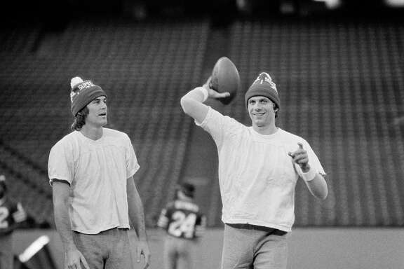 San Francisco 49ers Dwight Clark (left) and Joe Montana wear their Super Bowl XVI hats as they go through a final workout in the Silverdome in Pontiac, Mich., on the day before the XVI Super Bowl in 1982.