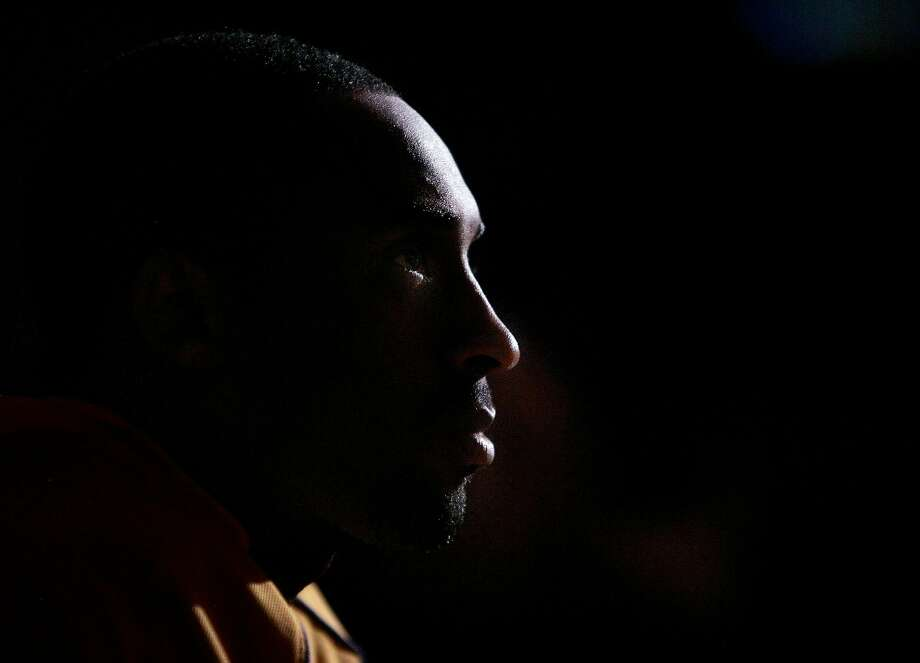 Los Angeles Lakers' Kobe Bryant waits to be introduced to the basketball court before the start of their game against the Golden State Warriors Tuesday, April 11, 2006, at Staples Center in Los Angeles. Lakers won, 111-100. (AP Photo/Kevork Djansezian) Photo: KEVORK DJANSEZIAN / AP