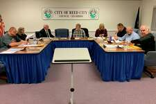 Reed City city council members discuss the topic of establishing recreational marijuana facilities within the city limits. Council approved a resolution prohibiting the establishment of marijuana facilities in May 2019. Councilman Nate Bailey requested they revisit the idea at the meeting on Jan. 22. (Herald Review photo/Cathie Crew)