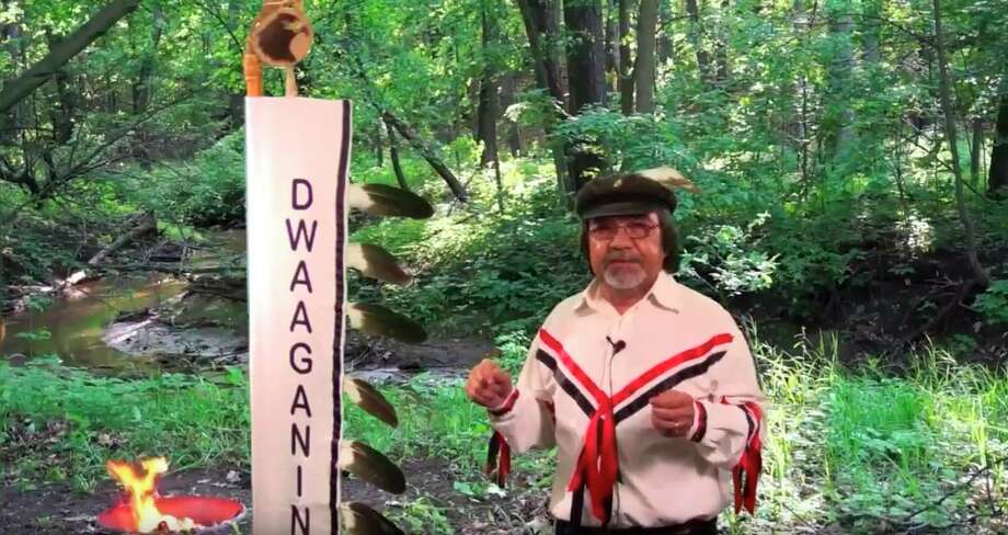 """Kenny Neganigwane Pheasant teaches his native language, anishinaabemowin through a series of videos he shares overFacebook. In this 2018 video """"the teaching of Dwaaganing Ginew Aatig"""" Pheasant teaches the history of the eagle staff. (Scott Fraley/News Advocate)"""