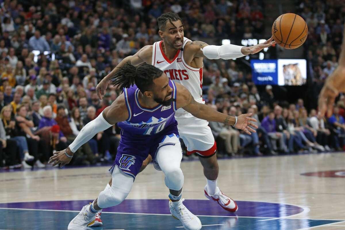 Houston Rockets forward Thabo Sefolosha, rear, steals the ball from Utah Jazz guard Mike Conley (10) in the second half of an NBA basketball game, Monday, Jan. 27, 2020, in Salt Lake City. (AP Photo/Rick Bowmer)