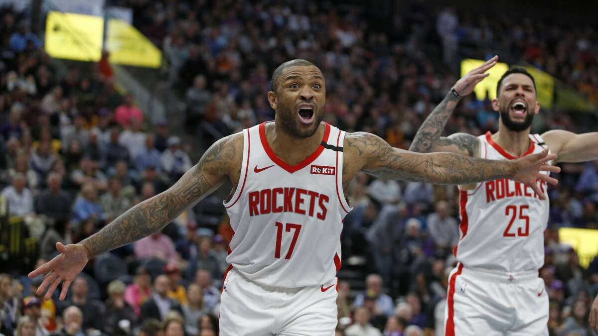 Houston Rockets forward P.J. Tucker (17) and guard Austin Rivers (25) react to a call in the second half of an NBA basketball game against the Utah Jazz, Monday, Jan. 27, 2020, in Salt Lake City. (AP Photo/Rick Bowmer)