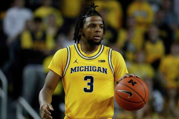 Michigan guard Zavier Simpson plays against Penn State in the second half of an NCAA college basketball game in Ann Arbor, Mich., Wednesday, Jan. 22, 2020. (AP Photo/Paul Sancya)