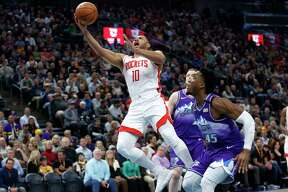 Rockets guard Eric Gordon goes in for two of his career-best 50 points past Jazz guard Donovan Mitchell on Monday in Salt lake City. Gordon finished 13 of 21 from the field, including six 3-pointers, and 14 of 18 from the free-throw line.