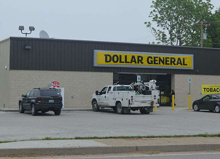 Customers enter a Dollar General store in Owenton, Kentucky. Dollar General's newly relocated store in Virginia will open Saturday.