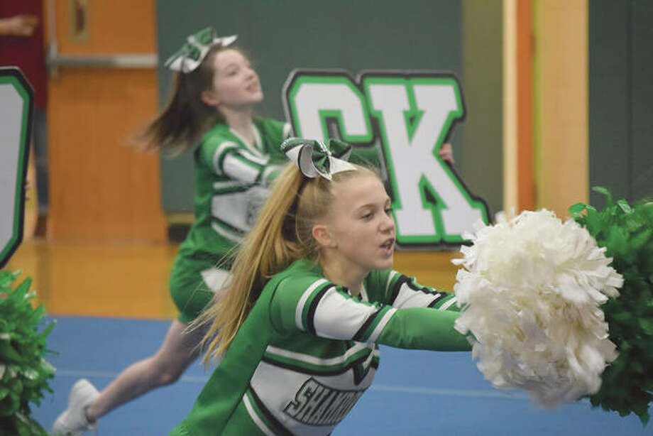 Captain Kennadi Johnson and other Our Saviour School cheerleaders go through a routine Monday. The team placed first in state competition during the weekend. Photo: Rochelle Eiselt | Journal-Courier