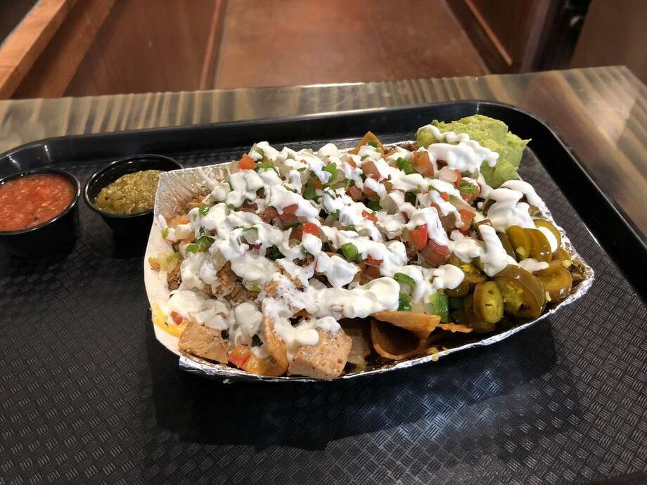 """Nacho Nachos, 1330 BroadwayWhat started as a food truck became a brick-and-mortar destination serving up Houston-themed nachos for every palate. Photo: Yelp/Monica F"""""""