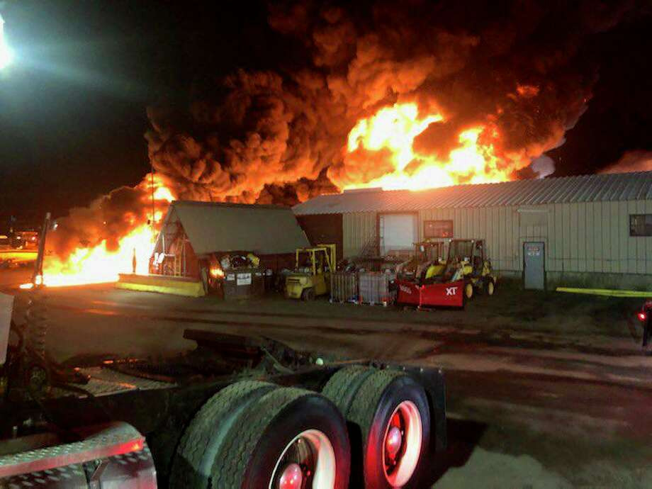Firefighters battled a massive fire near Brainard airport Tuesday morning on Jan. 28, 2020. The fire broke out in Central Auto & Transport business at 195 Maxim Road around 5 a.m. Photo: Hartford Fire Department Photo