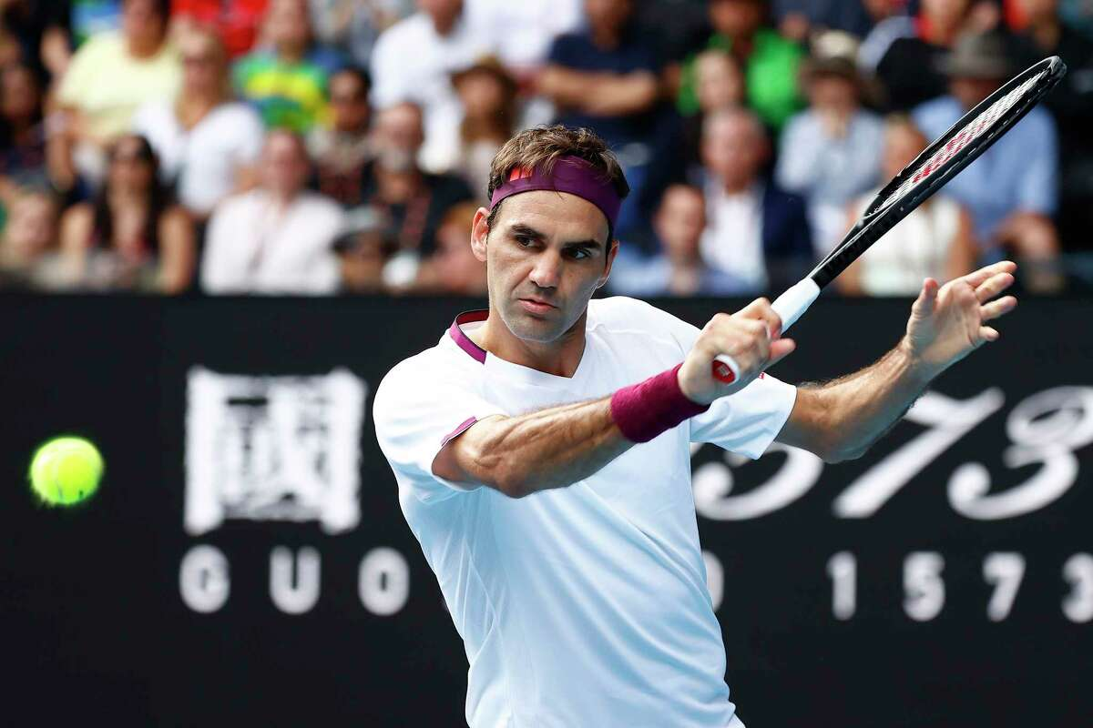 MELBOURNE, AUSTRALIA - JANUARY 28: Roger Federer of Switzerland plays a backhand during his Mens Singles Quarterfinal match against Tennys Sandgren of the United States on day nine of the 2020 Australian Open at Melbourne Park on January 28, 2020 in Melbourne, Australia.