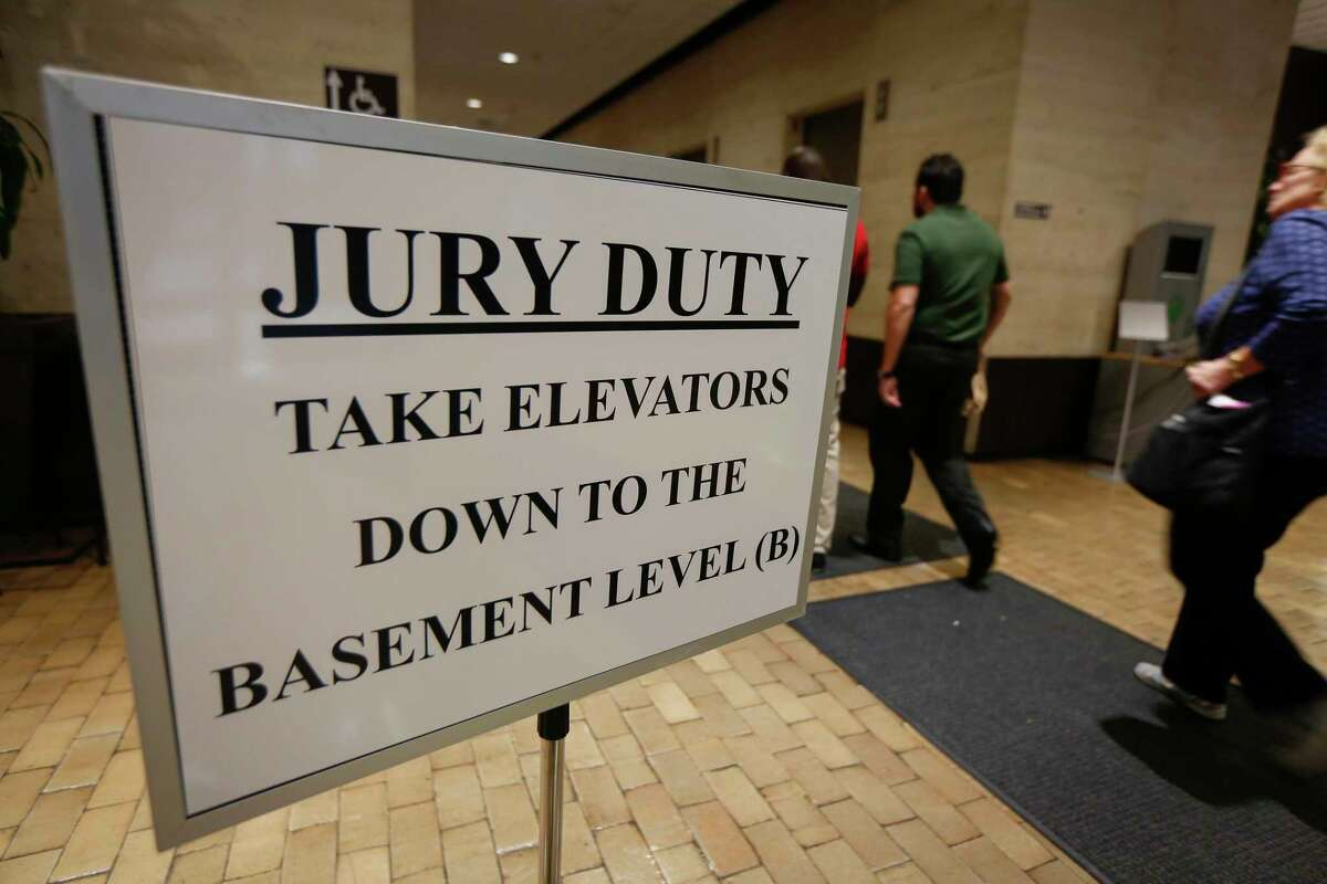 A sign directs Harris County residents to the Harris County jury assembly room Wednesday, Jan. 15, 2020, in Houston.