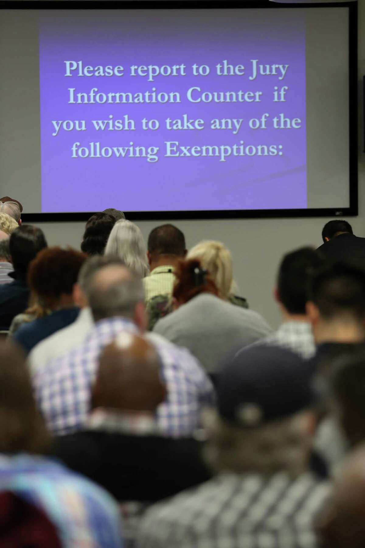 Harris County residents are called for jury duty fill the jury assembly room Wednesday, Jan. 15, 2020, in Houston.
