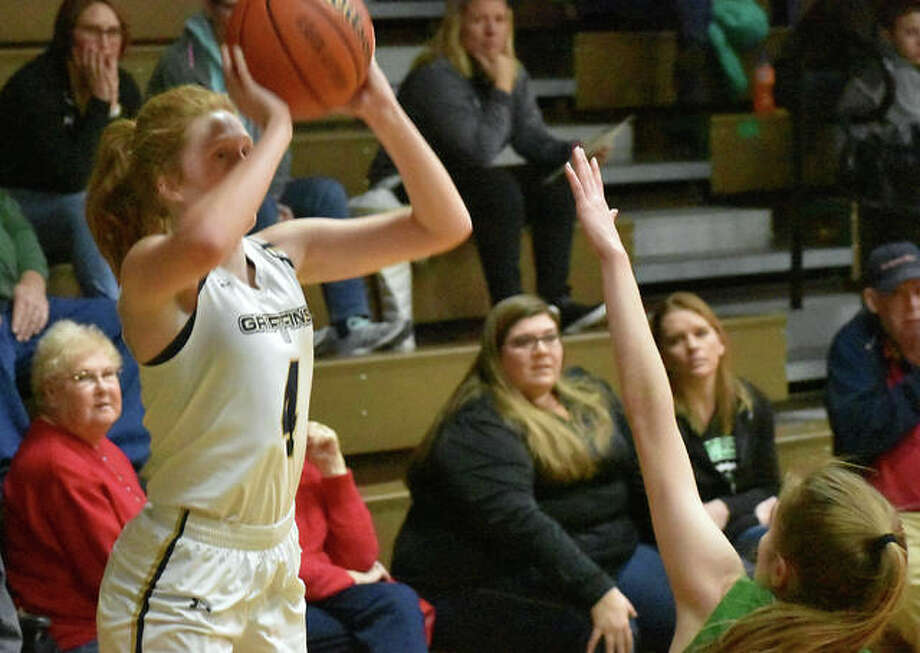 FMCHS shooting guard Anna McKee puts up a 3-pointer from the corner in the first half Monday in Carrollton.