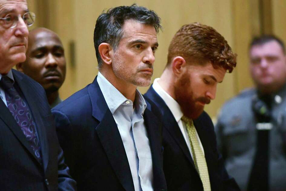 FILE - In this Jan. 8, 2020 file photo, Fotis Dulos, the estranged husband of a missing mother of five who is presumed dead, is arraigned on murder and kidnapping charges in Stamford Superior Court, in Stamford, Conn. According to a state prosecutor, Dulos violated the terms of his release on $6 million bond because he was seen removing items from a memorial for his wife set up near his home. Stamford State's Attorney Richard Colangelo filed a court document Wednesday, Jan. 22 asking a judge to modify the bond for Dulos. (Erik Trautmann/Hearst Connecticut Media via AP, Pool)