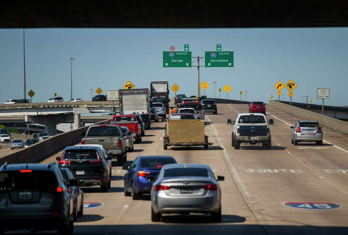 Traffic chooses between lanes for Interstate 45 north and Interstate 45 south towards downtown Houston on June 12, 2019.