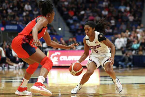 UConn's Crystal Dangerfield (5) is defended by Nneka Ogwumike (16) of the United States during a USA Women's National Team Winter Tour 2020 exhibition at The XL Center on Monday in Hartford.