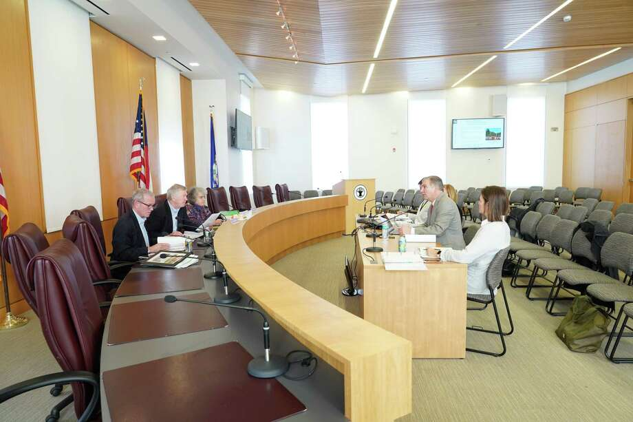 New Canaan Superintendent of Schools Dr. Bryan Luizzi recently explains the town's school district budget to the town's Board of Selectmen flanked by Board of Education Chair Katrina Parkhill looking on, and Dan Clark, the manager of the district's buildings. Luizzi presented to the Board of Selectmen including Nick Williams, First Selectman Kevin Moynihan, and Kit Devereaux in New Canaan Town Hall. The school board has argued at their meeting on Monday, July 13, 2020, against the removal of plans to change the times school starts in the district's buildings from the list of goals the board has for the district for the 2020-21 school year. Photo: Grace Duffield / Hearst Connecticut Media