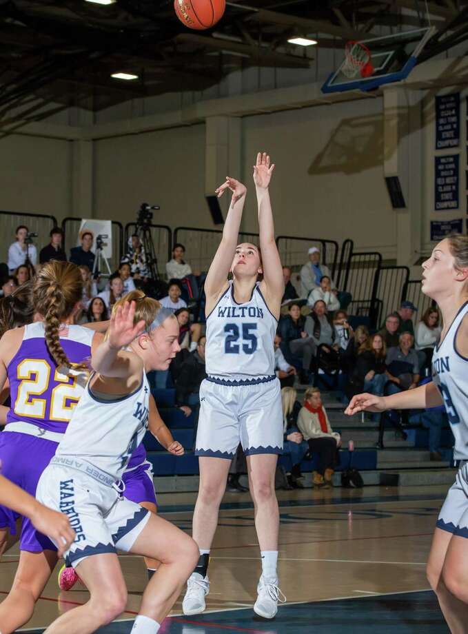 Riley Eaton launches a shot during a recent Wilton girls basketball game. Photo: Gretchen McMahon / For Hearst Connecticut Media