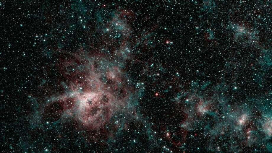 Spitzer's infrared vision shows off the wispy nature of the Tarantula Nebula. Photo: NASA/JPL-Caltech