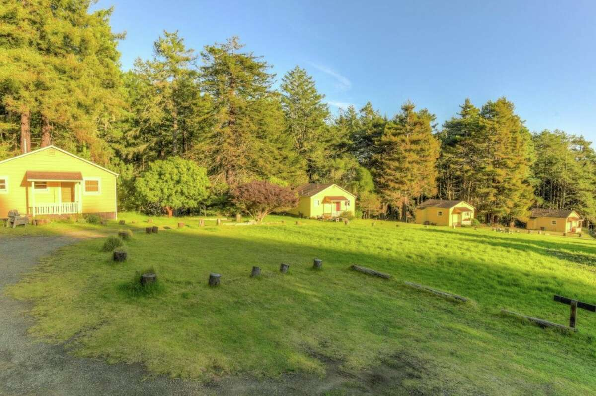 The coastal vacation community of 11 rental cabins and one owners cabin on nine acres is asking $2.495 million.