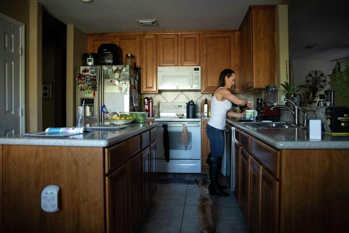 Stephanie Dudley prepares a protein snack in her kitchen on Dec. 19, 2019.