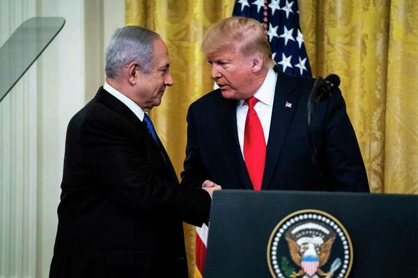 President Donald Trump shakes hands with Israeli Prime Minister Benjamin Netanyahu at the White House on Tuesday, Jan. 28, 2020.