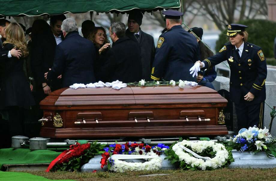 Family, friends and fellow officers including Deputy Chief Sue Zecca mourn the loss of beloved Norwalk police officer Cesar Ramirez Tuesday, January 28, 2020, at St. John's Cemetery in Norwalk, Conn. Photo: Erik Trautmann / Hearst Connecticut Media / Norwalk Hour