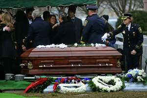 Family, friends and fellow officers including Deputy Chief Sue Zecca mourn the loss of beloved Norwalk police officer Cesar Ramirez Tuesday, January 28, 2020, at St. John's Cemetery in Norwalk, Conn.