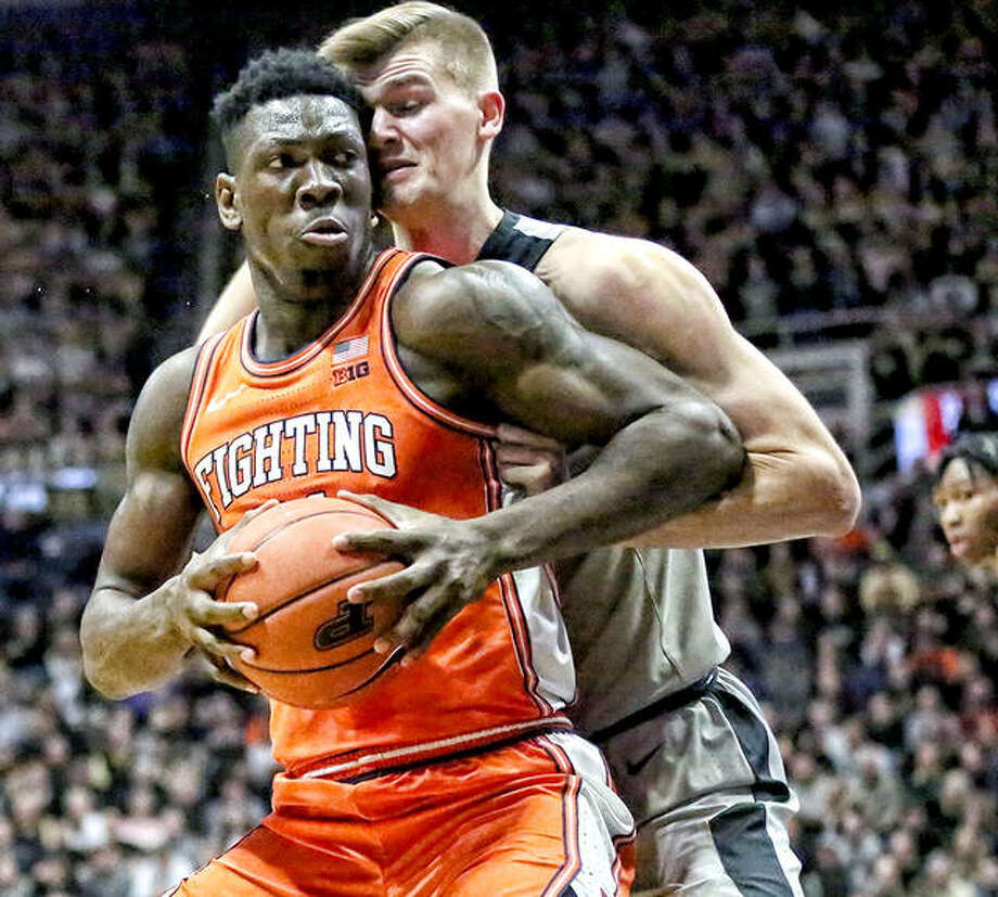 Kofi Cockburn of Illinois, left, has been named the Big Ten Freshman of the Week for the seventh time this season. He is shown in action at Purdue.