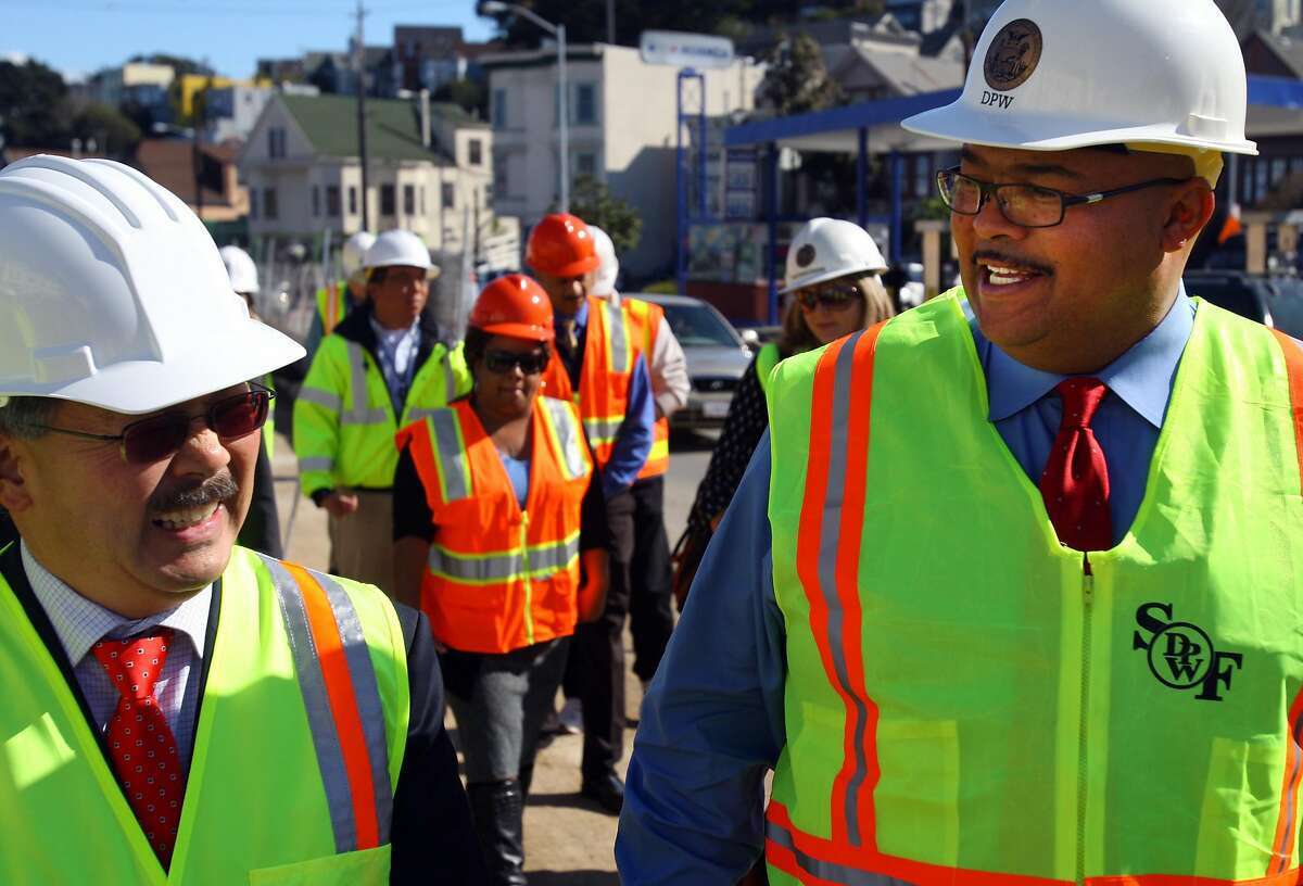 Mayor Ed Lee (Left) talks with Interim Head of the Department of Public Works, Mohammed Nuru (right), at the construction site at Cesar Chavez and Florida St. in San Francisco, Calif., on Friday, Nov. 4, 2011.