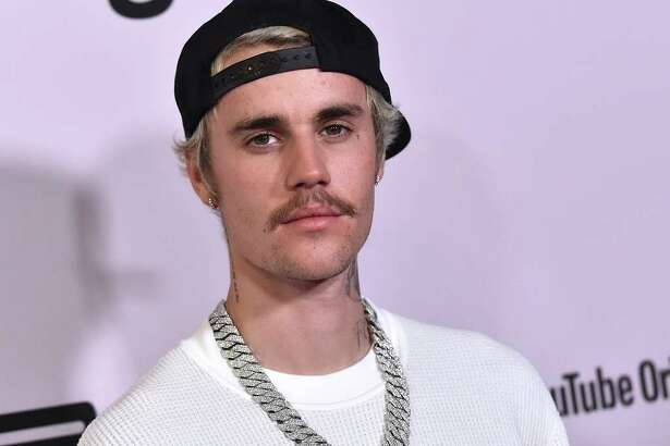 "Canadian singer Justin Bieber arrives for YouTube Originals' ""Justin Bieber: Seasons"" premiere at the Regency Bruin Theatre in Los Angeles on January 27, 2020. (Photo by LISA O'CONNOR / AFP)"