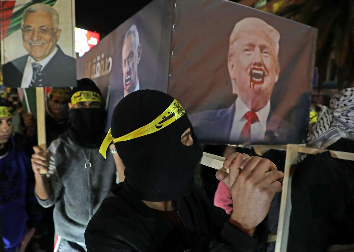 Palestinians carry a mock coffin on US President Donald Trump during a demonstration in the West Bank city of Nablus on January 28, 2020. - Palestinians staged protests against US President Donald Trump's Middle East peace plan, hours before it was to be unveiled in Washington. Thousands demonstrated in Gaza, burning pictures of Trump and the American flag, while further rallies were planned for the coming days. (Photo by Jaafar ASHTIYEH / AFP) (Photo by JAAFAR ASHTIYEH/AFP via Getty Images)