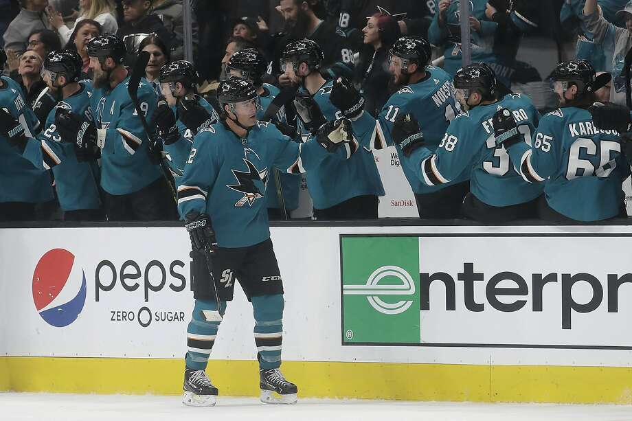 San Jose Sharks left wing Patrick Marleau, foreground, is congratulated by teammates after scoring a goal against the Anaheim Ducks during the second period of Monday's game. Photo: Jeff Chiu / Associated Press