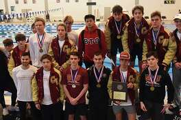 The Cypress Woods High School boys' swimming team won the District 18-6A team championship for the fourth year in a row.