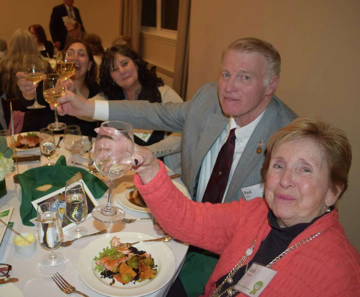 Paul Murphy and Lois Chludzinski were among the guests who made a toast during the evening's festivities at 19 Main.