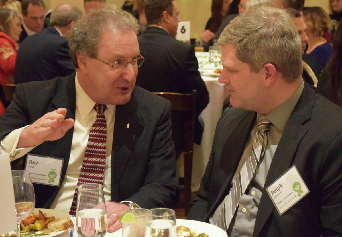 Local businessmen Ray Kostka, left, and Ralph Williams share conversation during dinner.