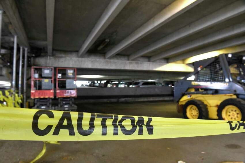 Caution tape blocks off a portion of the first floor of the Uncle Sam Garage on Tuesday, Jan. 28, 2020 in Troy, N.Y. (Lori Van Buren/Times Union)