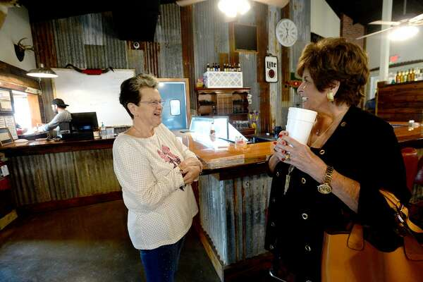 Martha Vautrot jokes with old friend Charlotte Holland, who moved to Conroe after her home of 41 years in Pinewood flooded during Harvey. Holland was the first to cross the threshhold at Vautrot's Cajun restaurant on its grand reopening Tuesday. The popular Bevil Oaks eatery was destroyed during Tropical Storm Harvey and operated out of a food truck while building a new restaurant. Photo taken Tuesday, Jan. 28, 2020 Kim Brent/The Enterprise
