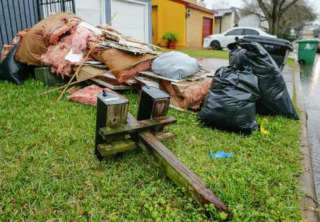 Broken mail boxes join home debris outside a house along Stanford Court just west of the Watson Grinding and Manufacturing facility in Houston.